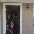 Homeowners standing in doorway of new home