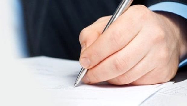 Human Hand penning a letter