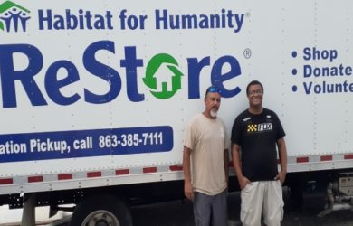 ReStore donation pickup truck and two crew members